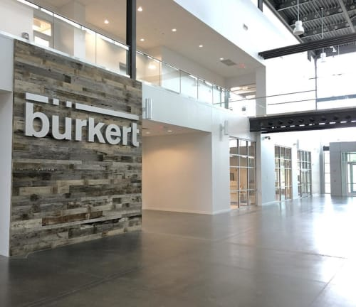 Wall Treatments by Wood Tender seen at Burkert Fluid Control Systems, Huntersville - Barn-wood Wall Clad
