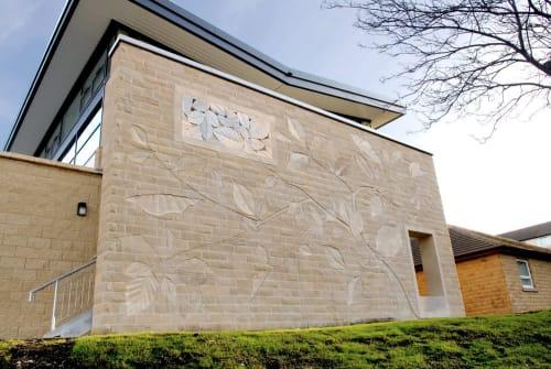 Sculptures by Alyoshastone seen at Batley Health Centre, Batley - Batley Wall