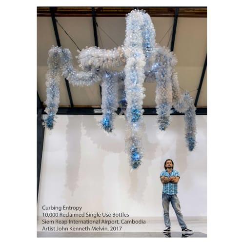 Sculptures by John Kenneth Melvin seen at Siem Reap International Airport, Krong Siem Reap - Curbing Entropy