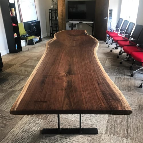 Tables by Slab Supply seen at Rao's, New York - Black Walnut Live Edge Table