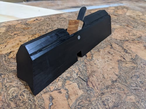 Hardware by Ney Custom Tables : Design and Fabrication seen at Private Residence, Brooklyn - Custom solid ebony chamfer plane