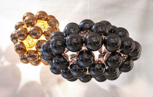 Pendants by Innermost seen at American Airlines Admirals Club, Queens - Beads