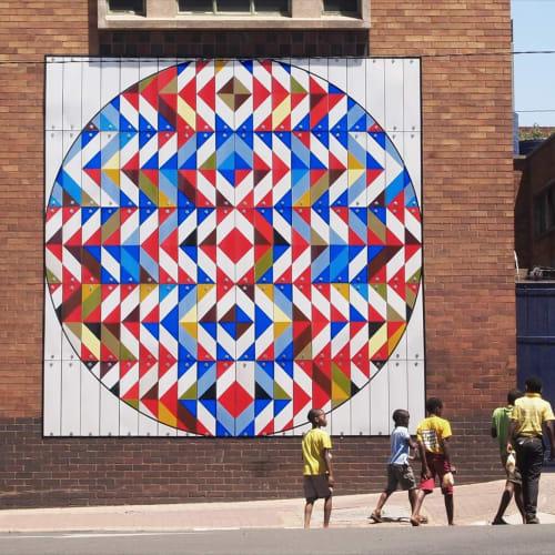 Murals by R1. seen at New Doornfontein, Johannesburg - Hidden Trophy