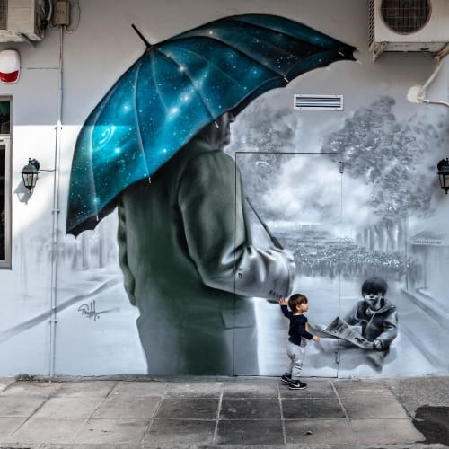Street Murals by SimpleG seen at Metaxourgeio, Athens - 'Under the shadow'