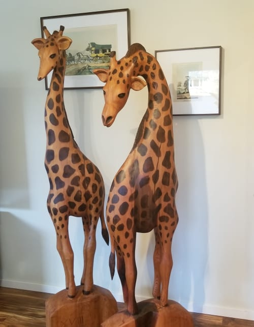 Sculptures by Toso Wood Works seen at Private Residence, North Vancouver - Giraffe Pair