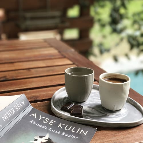 Cups by Beste Ogan Design seen at Private Residence, Istanbul - ADA 'Pebble Series' marbled mini tray & TABAK 'Leather Series' espresso cups