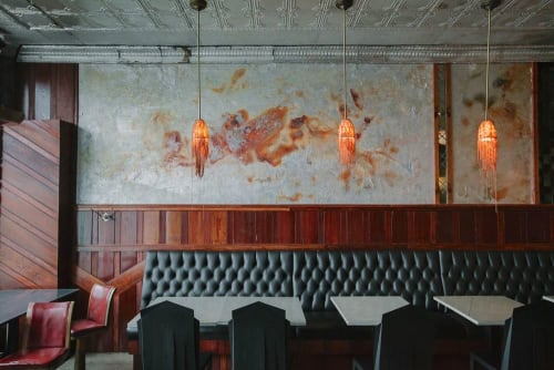 Murals by Paul Seftel seen at Eastern Market, Detroit - The Detroit Phoenix. Custom mural with stone and metal minerals