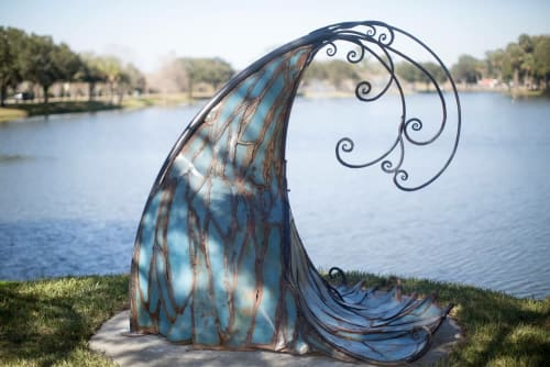 """Public Sculptures by Corrina Sephora seen at Ocala Tuscawilla Park, Ocala - """"Crest of the Wave"""""""