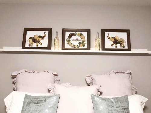Paintings by Oxeye Floral Co seen at Calgary, Calgary - Wood cut floral wreath and elephant print
