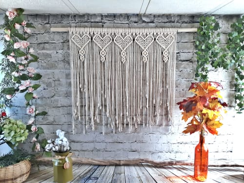 Macrame Wall Hanging by Desert Indulgence seen at The Love Hub, Airbnb, Williams - Macrame Heart Panel used as a curtain.