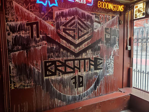 Murals by D Young V seen at Edinburgh Castle Pub, San Francisco - BREATHE