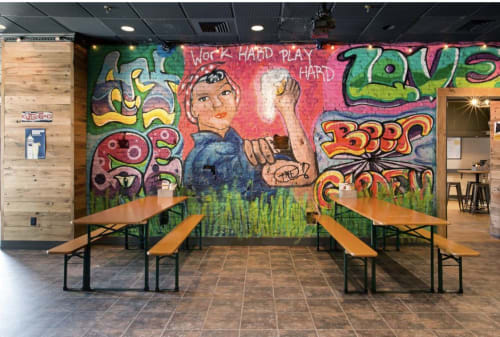 Murals by Joey Free seen at Two Saints Tavern, Boston - Rosie the Riveter