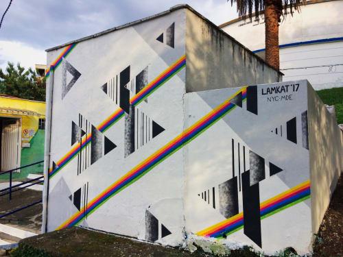 Street Murals by LAMKAT seen at Comuna 13 - Cementario de San Javier
