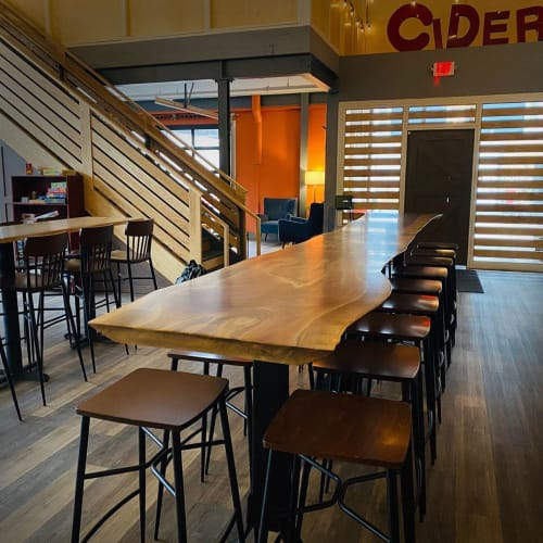 Tables by Created Hardwood seen at Number 12 Cider, Minneapolis - Live Edge Walnut Long table