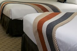 Linens & Bedding by Studio Twist seen at Skamania Lodge, Stevenson - Knitted Throw in Polypropylene & Polyplush - Custom Herringbone