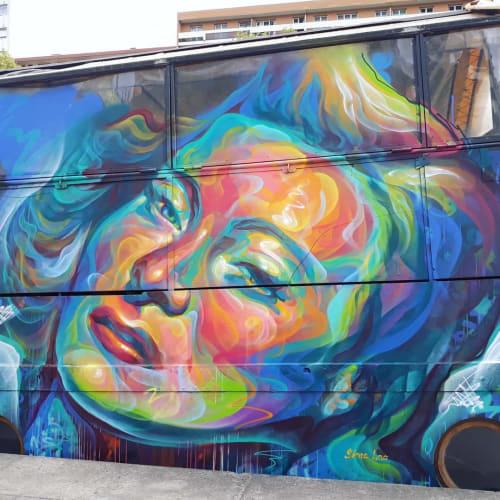 """Street Murals by Sema Lao seen at Grande Fantaisie, Paris - """"Quai des Brumes- looks of a woman"""""""