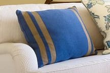 Linens & Bedding by Studio Twist seen at Montage Palmetto Bluff, Bluffton - Knitted Throw and Pillows in Polypropylene & Polyplush