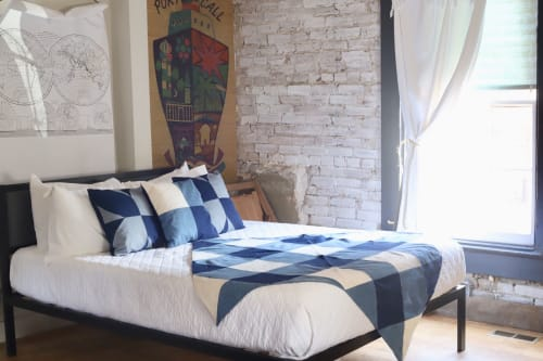 Linens & Bedding by Storyteller Studio seen at Private Residence, Louisville - Denim Magnolia Throw Pillow and Denim Gingham Throw Pillow