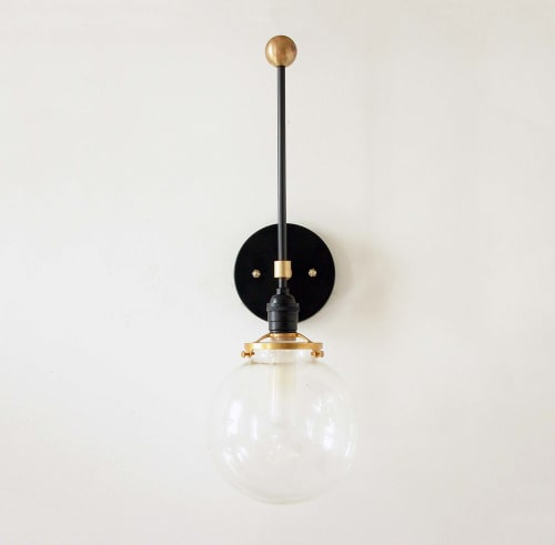 Sconces by DLdesignworks LLC seen at Private Residence - Moder black and gold wall sconce light with glass globe