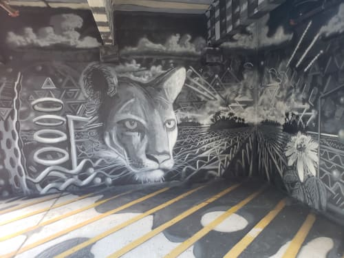 Murals by Drake Arnold seen at 105 SW 3rd St, Gainesville - Augmented Reality Mural at the Southwest Downtown Garage