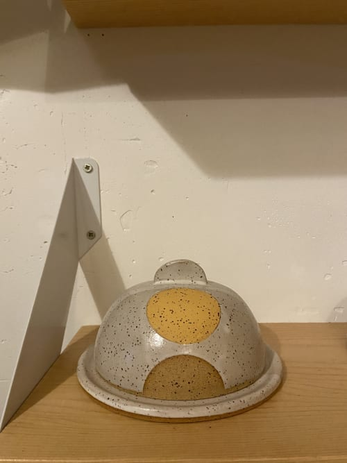 Tableware by Margaret and Beau Ceramics seen at Cupboard Goods, Portland - Half of the Whole Butter Dish in Marigold
