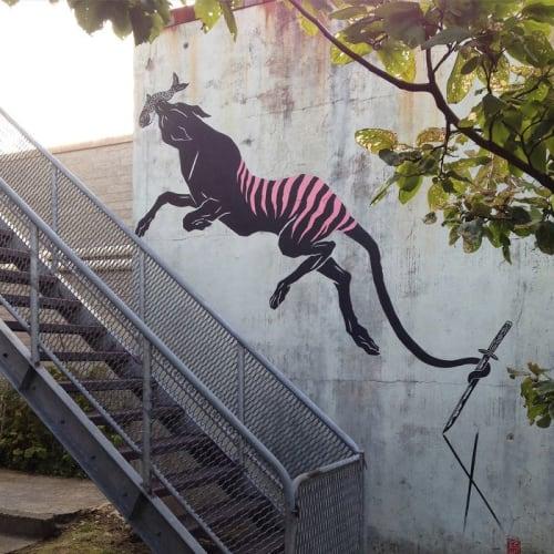 Murals by Creature Creature seen at 37 Orr St, Queenstown - Tasmanian Tiger