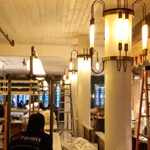 Lighting by E. Kraemer Metal & Woodwork seen at Justine, New Orleans - Brass Lighting