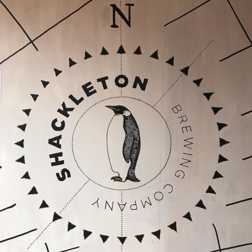 Murals by Cape Town Signwriting seen at Shackleton Brewing Company, Cape Town - Logo Sign and Antarctic Map