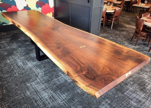 Tables by CZ Woodworking seen at Tavola Restaurant + Bar, Springfield - Live Edge Walnut Dining Table