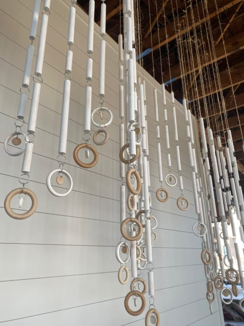 Interior Design by Emily Barton Design seen at Provision, Hartwell - Hanging Wood Dowel and Ring Installation