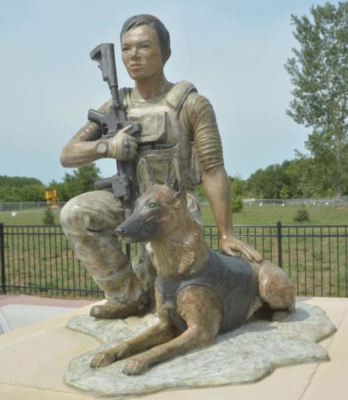 """Public Sculptures by Bahary Studios Inc seen at Siouxland Freedom Park, South Sioux City - SEAL team 6 John Douangdara and his Belgian Malinois war dog """"Bart"""""""