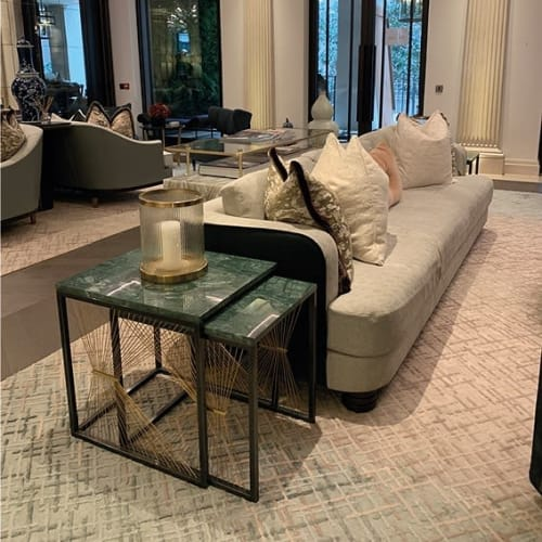 Tables by Ziad Alonaizy Design seen at Twenty Grosvenor Square, a Four Seasons Residence, London - AEGIS 001 nesting tables