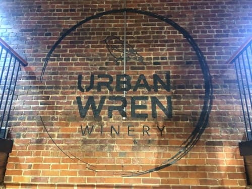 Murals by Hennessey In The Home seen at Greenville, Greenville - Urben Wren Winery - Hand Painted Logo