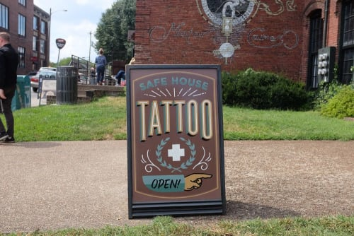 Signage by Finer Signs seen at Safe House Tattoo Studio, Nashville - Safe House Tattoo Board Sign