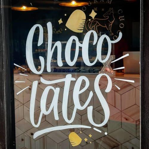 """Murals by La María seen at Xocogram Chocolates, Ensenada - """"Chocolates"""""""