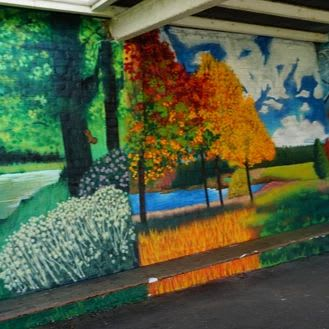 Murals by C-That seen at Gallions Mount Primary School, London - Murals