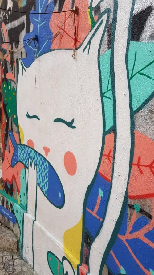 Street Murals by Its mancho seen at Escadinhas de São Cristóvão, Lisboa - Miau na Tajo