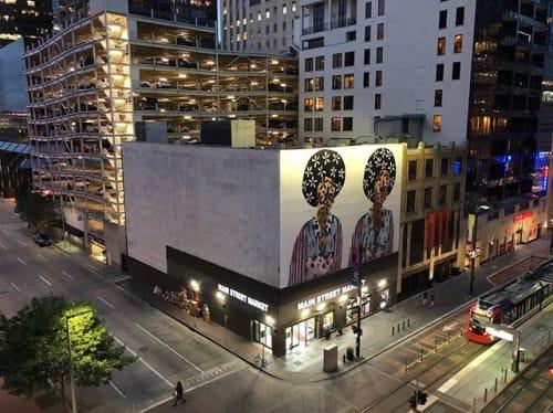 "Street Murals by Jasmine Zelaya seen at Main Street Square, Houston - Main Street Marquee ""Twins"""