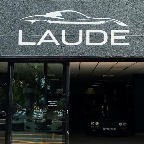 Signage by Cape Town Signwriting seen at LAUDE Classic Cars, Investment Cars, Sports Cars, Cape Town - Casual Lettering