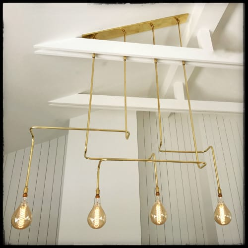 Pendants by Buzzell Studios seen at Private Residence, Newport Beach - Brass 4 Bulbs Pipe Pendant