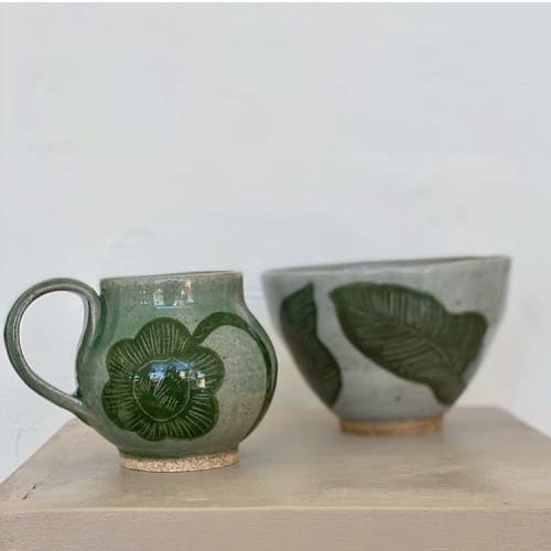 Cups by Muddythings by Mayon Hanania seen at Marida- Jewelry and Gifts, Long Beach - Celadon Green skull flower mug