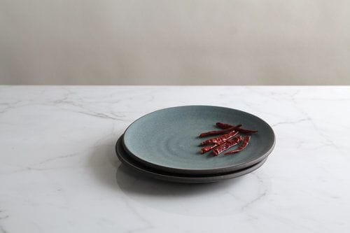 Ceramic Plates by Jono Pandolfi seen at Four Seasons Hotel New York Downtown, New York - Coupe Salad Plate