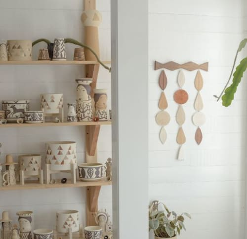 Wall Hangings by Heidi Anderson HASTUDIO seen at 23920 104th Ave SW, Vashon - Ceramic wall hanging with decorative wood design