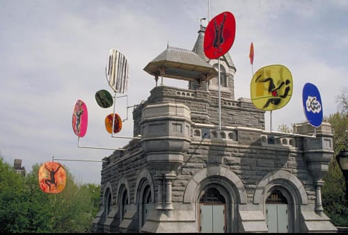 Public Sculptures by Ross Lewis Studio seen at Belvedere Castle, New York - FANSCAPES Belvedere Castle, Central Park, NY 1993, 9 wind-activated painted nylon fans stretched on 5' diameter stainless steel hoops mounted on steel poles projecting from the castle walls.