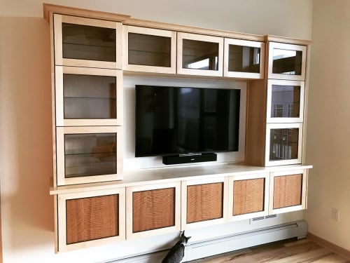 Furniture by Heirloom Custom Woodworks LLC seen at Portland Tower, Minneapolis - Lighted media cabinetry