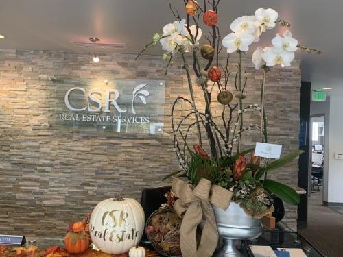 Floral Arrangements by Fleurina Designs seen at CSR Real Estate Services, San Jose - Fall Orchid Arrangement