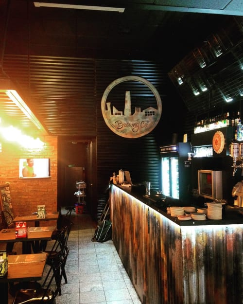 Murals by Eneicekao seen at Burgerdog, Providencia - Rusty Metal Style Painting