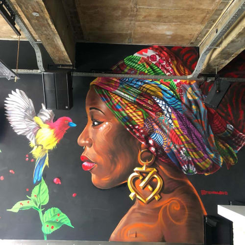 Murals by Mohammed Awudu seen at Plot 7, Accra - Lady and bird Mural