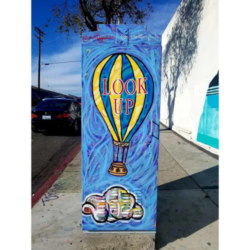 Murals by Mitchelito Orquiola seen at Venice Boulevard, Los Angeles - Look Up