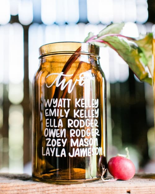 Signage by Michelle Edwards seen at Rooted Farmstead, LLC, Bellefonte - Seating arrangement lettering on glass jars